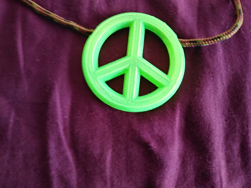 Peace symbol necklace, glow under UV plastic